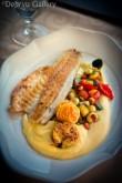 Sea bass, shrimp, and scallop with lemon purée and sautéed Mediterranean vegetables. Lake Bled Castle, Slovenia, June 2013. Photo © Deja'vu Gallery